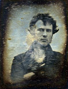 Philadelphia, November 1839. Robert Cornelius, self-portrait facing front, arms crossed. Inscription on backing: The first light-picture ever taken. 1839.