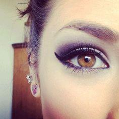 Beautiful brown eye with makeup.