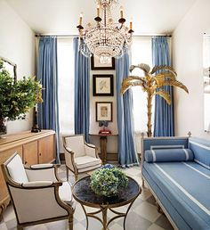 French daybed with tape trim, matching drapes with tape trim too, and that BRASS PALM TREE. Legit all I need is a brass palm tree.