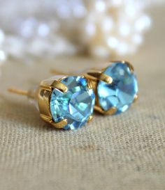 Blue and gold earrings - 14k gold plated earrings with real blue  faceted  swarovski rhinestone. $15.00, via Etsy.