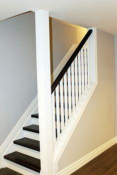 Dark wood + white trim & railing + grey walls  Basement stairs??