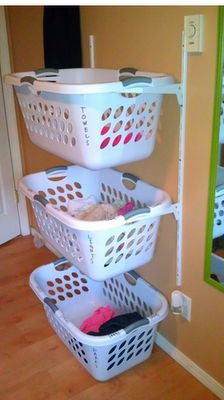 My hubs always complains of the lack of space in the wash room Maybe something like this would help...