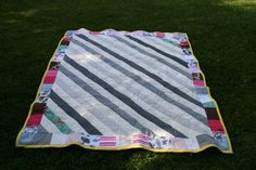I made my own keepsake quilt!! The inside I used this blog as a guide: http://sewmamasew.com/blog2/2010/04/simple-triangle-block-sew-along/ The outside I chopped up some of my favorite of her baby clothes, with the most memories etc that still worked within the color scheme. I tried to stay away from onesies with words, with one exception: the first outfit we ever bought for her :)