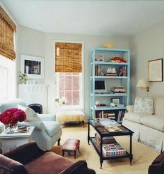 love this room from Domino Magazine and love the blue shelf