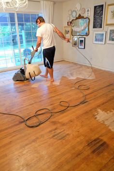 Refinishing Our Hardwood Floors