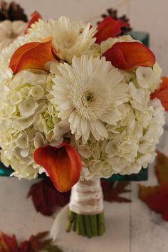 white gerbera daisies, white hydrangeas, and orange calla lilies