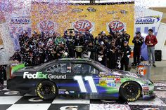 Denny Hamlin and the No. 11 Fed Ex Ground Toyota and team in Victory Lane at Kansas Speedway after Hamlin held off Martin Truex Jr. to clinch his second win of the season.