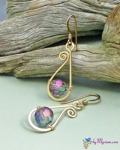 Spiral raindrop wire earrings ... sculpted 14 kt. GF  Swarovski crystals, from byMyriam.com ... wire jewelry