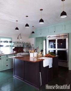 Designer Jeffrey Bilhuber updated his traditional Dutch kitchen with a blue-green color on the woodwork.