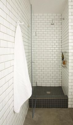 Love this small shower with subway tile for a small bathroom.