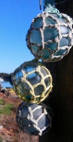 Antique Japanese glass fish net floats.
