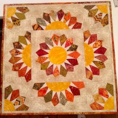 A wall hanging made from Moda fall fabrics and batiks.
