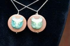New one of a kind Whoo owl necklaces. Handcrafted with resin castings and framed by a round wooden pendant.  Double sided with a floral pattern vintage fabric button.  available on my Etsy shop...  http://www.etsy.com/shop/idlehandsdesigns