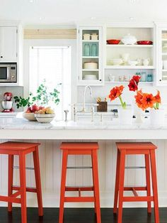 love  Fun small kitchen with the splashes of color.