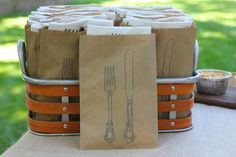 I think this is cute and practical.  It's always hard to juggle your silverware and napkin as you get your food.  This holds it all together.