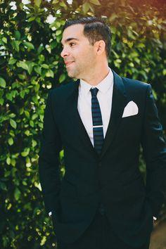 sharp looking groom, photo by Lauren Scotti http://ruffledblog.com/modern-parker-palm-springs-wedding #grooms #suit