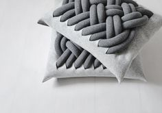 KNOTTY pillow (jersey tubes stuffed with polyurethane foam, knotted together and attached to a 100% woolen felt pillow)