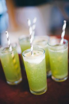 striped gray straws in a bright green drink - Sayulita, Mexico destination wedding photo by Mexico wedding photographer Jillian Mitchell