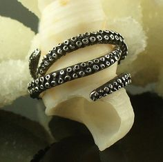 Neato! rings cast from octopus tentacles - from OctopusMe on etsy