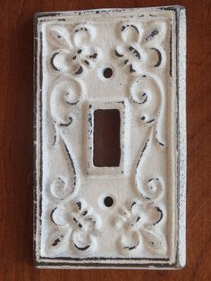 Antique White Light Switch Cover / Light Plate Cover / Cast Iron / Wall Decor / Fleur de lis Pattern. $8.99, via Etsy.