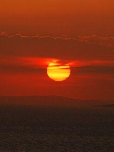Sunset off the coast of Greece