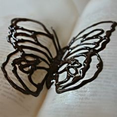 If you feel like getting fancy...Use an open book lined with wax paper to let your chocolate butterfly harden & create the realistic pose of a butterfly!