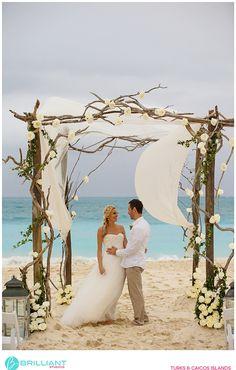 Rustic driftwood style beach wedding arch in The Caribbean. Brilliant Studios, Turks and Caicos. Grace Bay Club weddings.