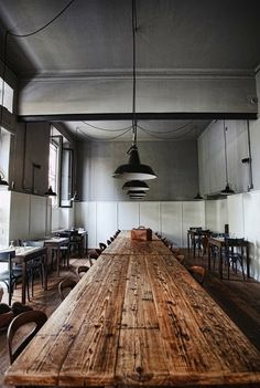 Raw wood table - cool restaurant tables - industrial lighting