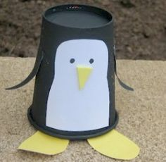 Make a penguin craft out of a paper cup! - A unique outdoor movie night theming idea from Southern Outdoor Cinema.
