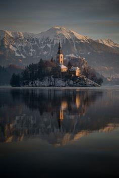 Winter sunrise at Lake Bled, Slovenia, Assumption of Mary Pilgrimage Church by Erik Meylemans