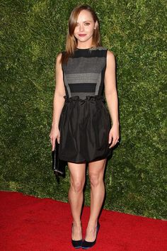 Christina Ricci attended the premiere of In Vogue: The Editor's Eye premiere wearing a short black dress with petrol blue satin heels.