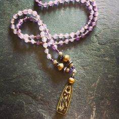 """ROX Amethyst and Heishi Pearl Tibetan Prayer Pendant Necklace with Mali and Indonesian Brass.   27""""  $125"""