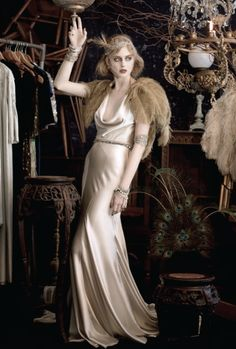 Feathers/karen cox....Beautiful in ivory, the 1920s style reflects a much more sophisticated wedding influence. #vintage #brides