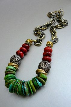 This blockbuster necklace is made with vivid, natural turquoise heshi beads and large, brushed gold love knots.