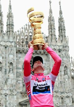 Giro d'Italia (2012) Photos; Stage 21: Milano 28.2 km (ITT) - The Trophy without end held aloft with the Duomo as a backdrop!