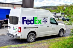 The Fedex Truck was Making a Delivery.