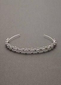 Enhance your look with this stunning silver headband.  Embellished with crystals and pearls for subtle sparkle.  Imported.  Available in Silver.