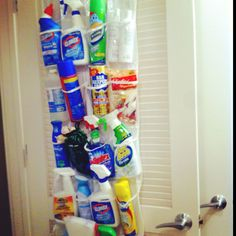 Cleaning products organized in over the door shoe rack