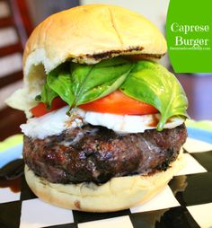 Caprese Burger: A mile high burger with fresh basil, mozzarella and tomato!