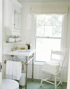 Like this idea of shelf under medicine cabinet. Pedestal sinks need that little extra area.