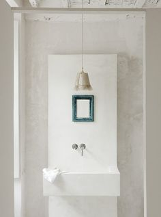 Block of mounted white..and the little teal mirror, feminine light fixture