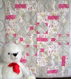 Whooo Loves You is a unique handmade baby quilt featuring little friendly owls on varying shades of soft pink baby flannel, mixed with the pink softness of minx.