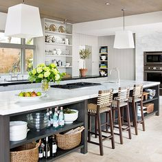 wood plank ceiling.  Dark lower cabinetry.  White walls. Adore the chairs.