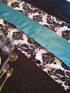 Table runners, maybe with red and white flowers?