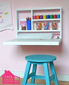 Kid's desk pulls down off wall---great space saver. Front is chalkboard framed in white.