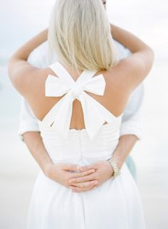 Obsessed with the back of this dress, complete with a sweet little bow! http://www.stylemepretty.com/destination-weddings/2014/10/31/summer-engagement-in-the-bahamas/ | Photography: Julie Cate - http://juliecate.com/