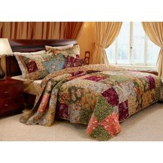 I'm drawn to this quilt. It warms up the room and looks cool, but also old fashioned.