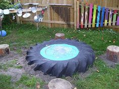 Banging post, chimes and a tractor tyre drum, awesome outdoor music set up! From Child Central Station: Making Music!
