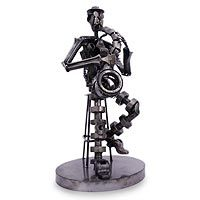 saxophone sculpture from car parts and bicycle parts