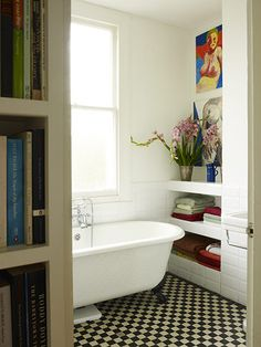 bathroom soaking tub niche shelves small square floor tiles Brixton house in The Guardian
